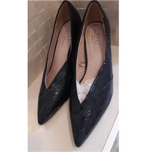 Next's heels